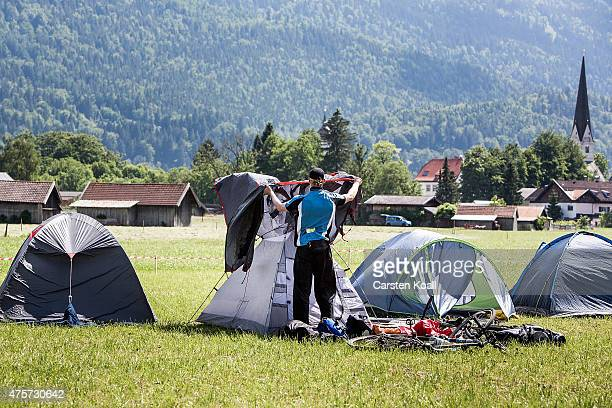 Activists who have come to protest against the nearby upcoming summit of G7 nation leaders prepare their tents at a campsite reserved for protesters...