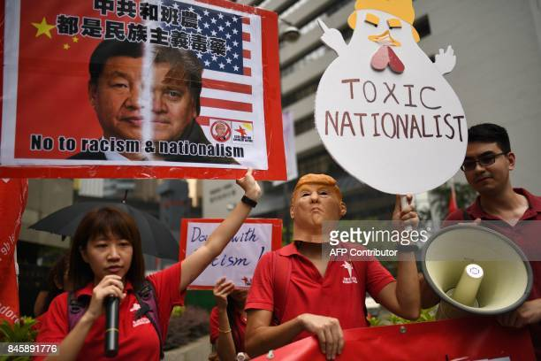 Activists with Hong Kong's League of Social Democrats hold up banners during a protest against US President Donald Trump and the visit of former...