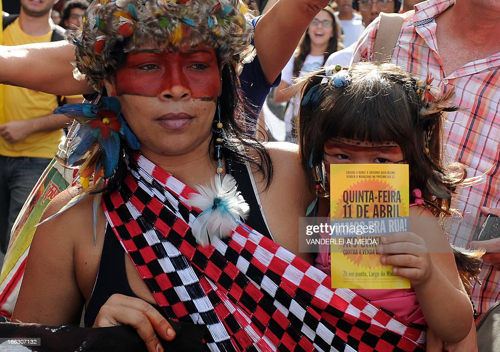 Activists --with some Brazilian natives among them-- protest in front of the Guanabara state government's palace against the privatization of the Mario Filho 'Maracana' stadium in Rio de Janeiro, Brazil, on April 11, 2013. Bidding for the privatization of Rio's iconic Maracana stadium was to go ahead as planned Thursday after a local court rejected an appeal to block the process. Maracana, which was built for the 1950 World Cup, is undergoing extensive renovation at a cost of 430 million dollars to host four Confederations Cup matches in June as well as seven World Cup games next year, including the finals of both tournaments.