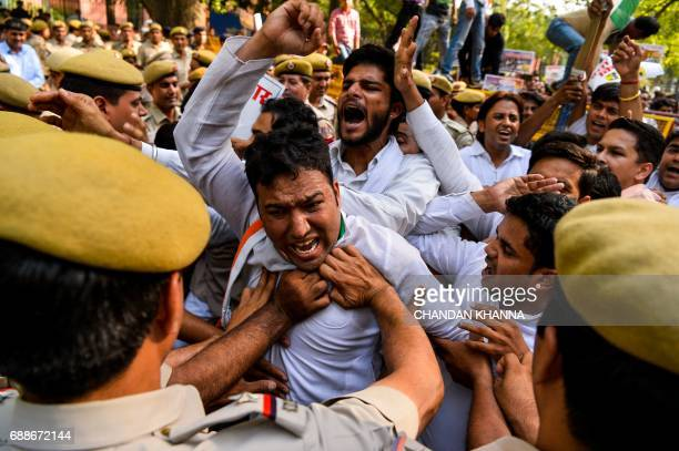 TOPSHOT Activists with the Indian Youth Congress shout antigovernment slogans during a protest following the completion of three years of National...