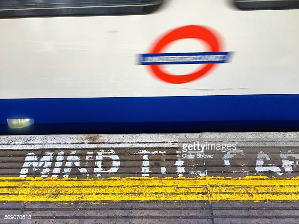 Acton tube station platform with sign MIND THE GAP 8 July 2015 London