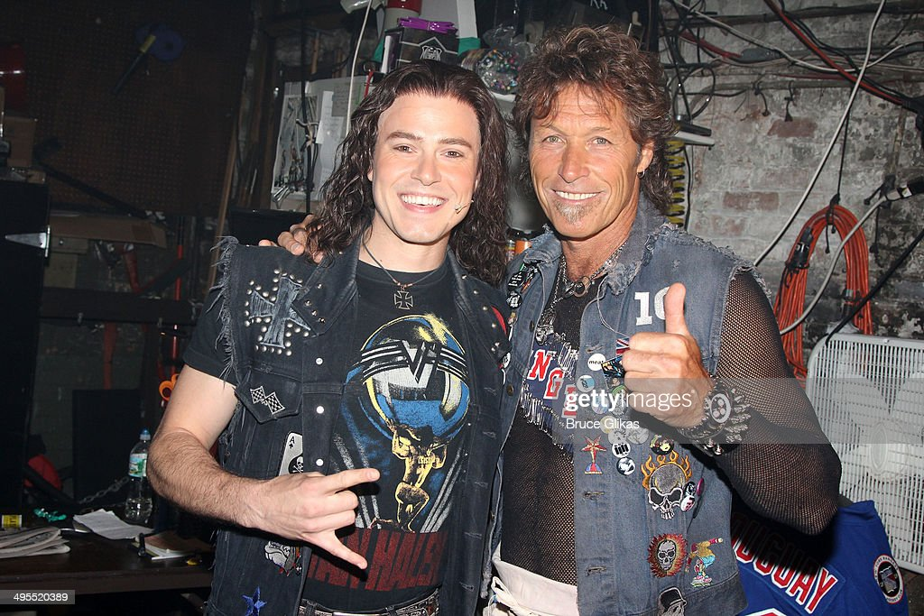 Actor Aaron C. Finley and Former New York Rangers hockey player <a gi-track='captionPersonalityLinkClicked' href=/galleries/search?phrase=Ron+Duguay&family=editorial&specificpeople=598468 ng-click='$event.stopPropagation()'>Ron Duguay</a> who made his broadway debut pose backstage at the hit musical 'Rock of Ages' on Broadway at The Helen Hayes Theater on June 3, 2014 in New York City.