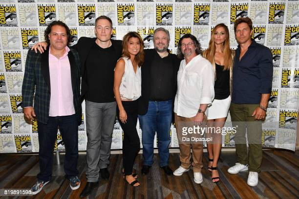 Actor Aaron Douglas actor Tahmoh Penikett actor Grace Park writer David Eick producer Ronald D Moore actor Tricia Helfer and actor Michael Trucco at...