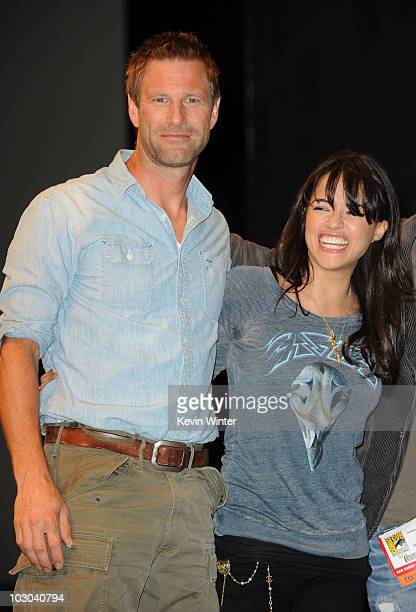 Actor Aaron Eckhart and actress Michelle Rodriguez pose onstage at the 'Battle Los Angeles' panel during ComicCon 2010 at San Diego Convention Center...