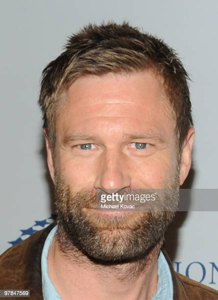 Actor Aaron Eckhart arrives at the Ferrari 458 Italia Brings Funds for Haiti Relief event at Fleur de Lys on March 18 2010 in Los Angeles California