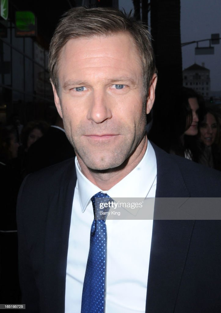 Actor Aaron Eckhart arrives at the Los Angeles premiere of 'Olympus Has Fallen' held at ArcLight Cinemas Cinerama Dome on March 18, 2013 in Hollywood, California.