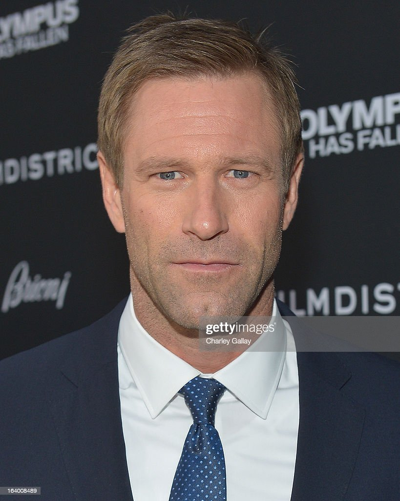 Actor <a gi-track='captionPersonalityLinkClicked' href=/galleries/search?phrase=Aaron+Eckhart&family=editorial&specificpeople=220602 ng-click='$event.stopPropagation()'>Aaron Eckhart</a> attends Brioni Sponsors Film District's World Premiere Of 'Olympus Has Fallen' ArcLight Cinemas on March 18, 2013 in Hollywood, California.