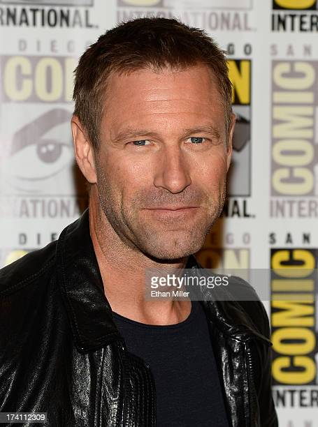 Actor Aaron Eckhart attends Lionsgate's 'The Hunger Games Catching Fire' and 'I Frankenstein' press line during ComicCon International 2013 at the...