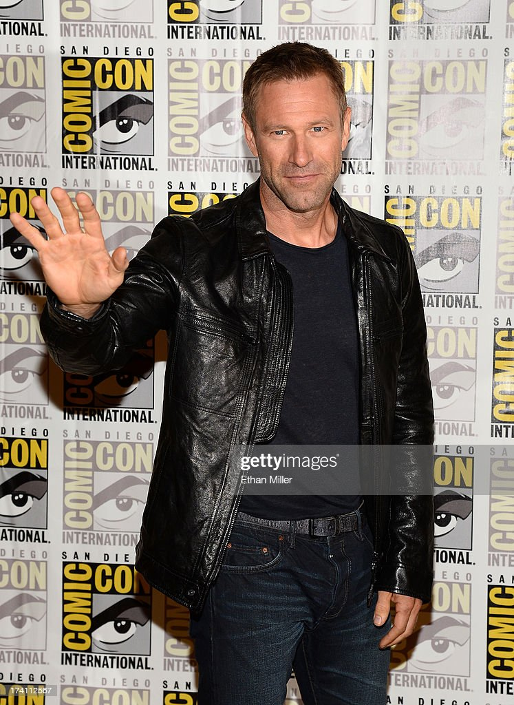 Actor <a gi-track='captionPersonalityLinkClicked' href=/galleries/search?phrase=Aaron+Eckhart&family=editorial&specificpeople=220602 ng-click='$event.stopPropagation()'>Aaron Eckhart</a> attends Lionsgate's 'The Hunger Games: Catching Fire' and 'I, Frankenstein' press line during Comic-Con International 2013 at the Hilton Bayfront on July 20, 2013 in San Diego, California.