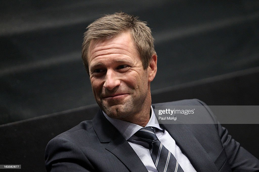 Actor <a gi-track='captionPersonalityLinkClicked' href=/galleries/search?phrase=Aaron+Eckhart&family=editorial&specificpeople=220602 ng-click='$event.stopPropagation()'>Aaron Eckhart</a> attends the 'Olympus Has Fallen' screening Q & A at AMC Loews Georgetown 14 on March 12, 2013 in Washington, DC.