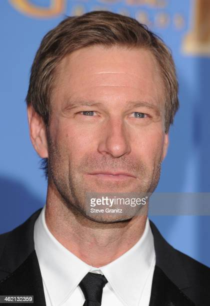 Actor Aaron Eckhart poses in the press room during the 71st Annual Golden Globe Awards held at The Beverly Hilton Hotel on January 12 2014 in Beverly...