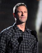Actor Aaron Eckhart speaks onstage during Spike TV's 'Scream 2010' at The Greek Theatre on October 16 2010 in Los Angeles California
