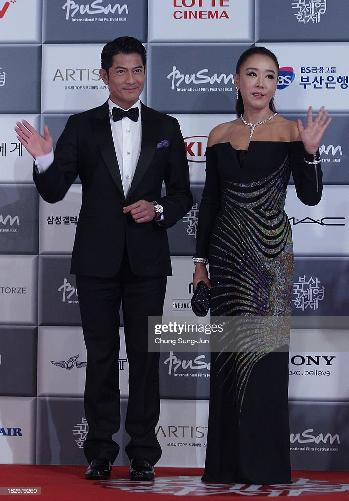 Actor Aaron Kwok and actress Kang Soo-Yeon arrive at the opening ceremony during the 18th Busan International Film Festival on October 3, 2013 in Busan, South Korea.