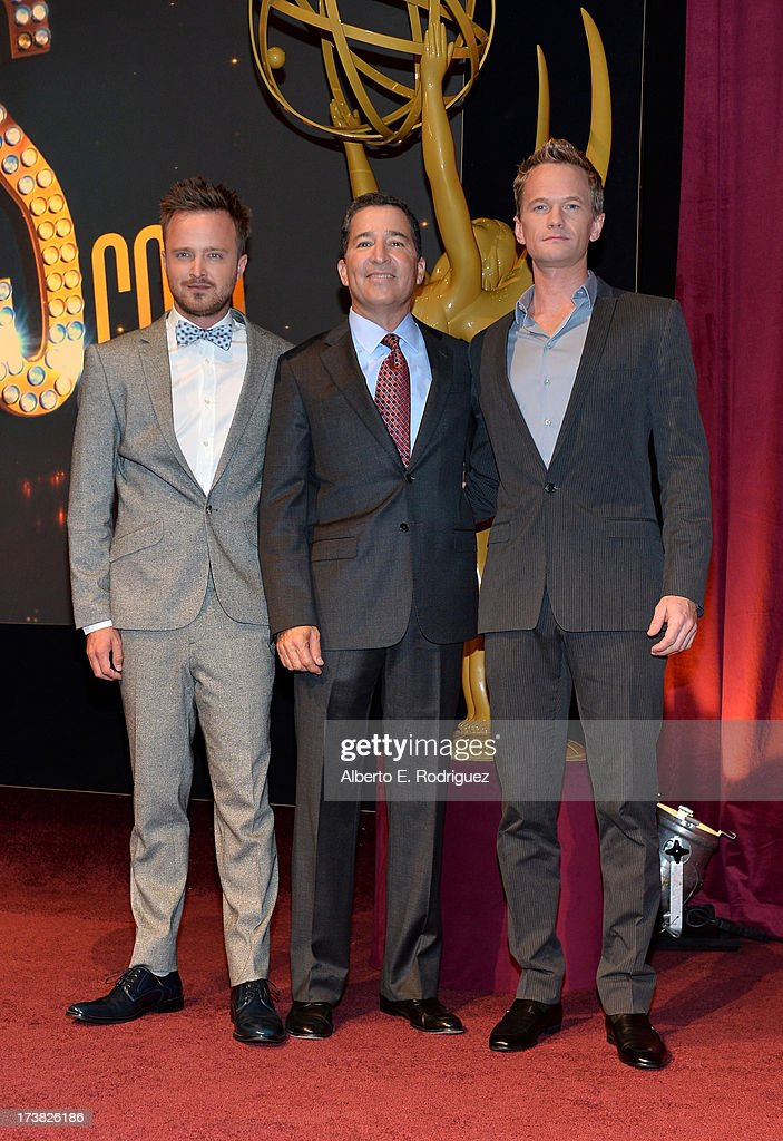 Actor Aaron Paul, Academy of Television Arts & Sciences Chairman & CEO Bruce Rosenblum and actor Neil Patrick Harris pose onstage following the announcement of the nominees for the 65th Primetime Emmy Awards nominations at the Television Academy's Leonard H. Goldenson Theatre on July 18, 2013 in North Hollywood, California.