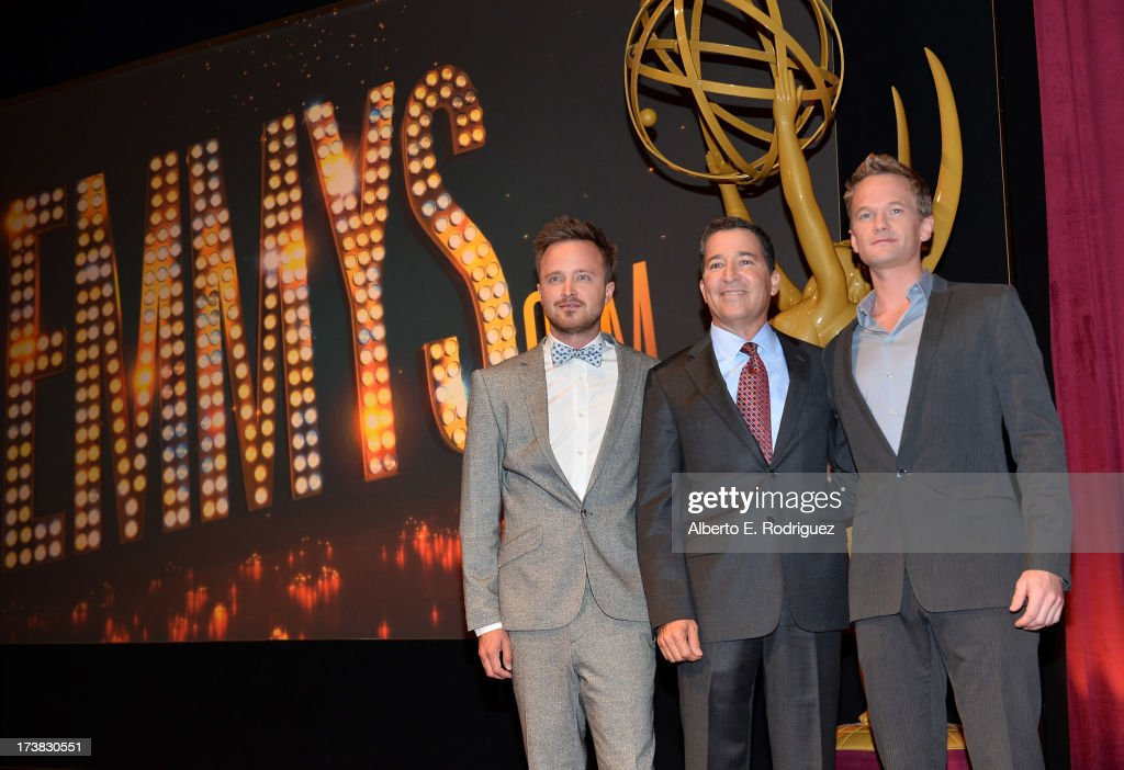 Actor Aaron Paul, Academy of Television Arts & Sciences Chairman & CEO Bruce Rosenblum and actor Neil Patrick Harris pose onstage following the 65th Primetime Emmy Awards nominations announcements at the Television Academy's Leonard H. Goldenson Theatre on July 18, 2013 in North Hollywood, California.