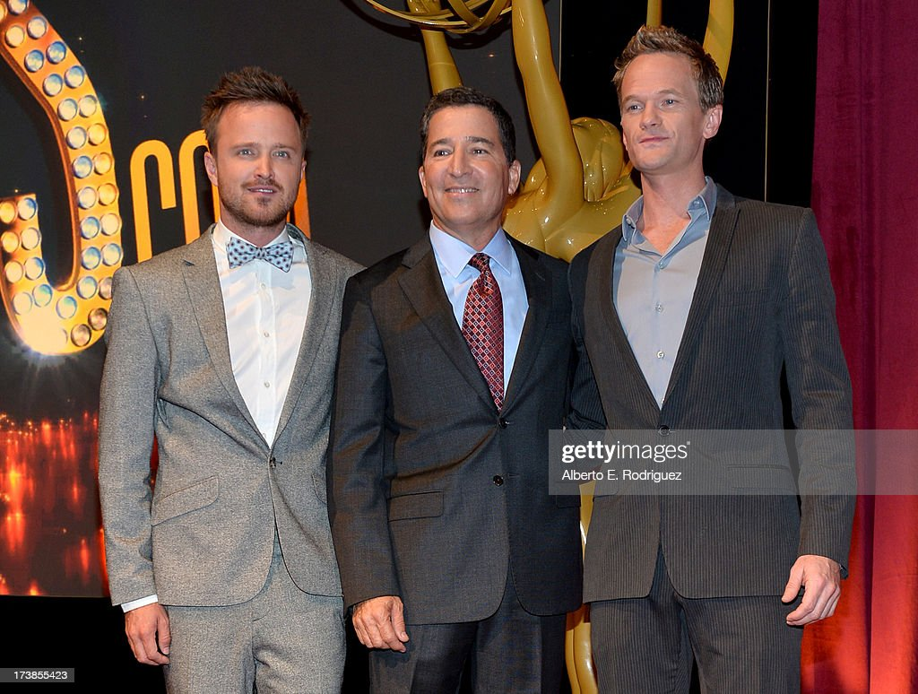 Actor Aaron Paul, Academy of Television Arts & Sciences Chairman & CEO Bruce Rosenblum and actor Neil Patrick Harris pose onstage following the 65th Primetime Emmy Awards nomination announcements at the Television Academy's Leonard H. Goldenson Theatre on July 18, 2013 in North Hollywood, California.