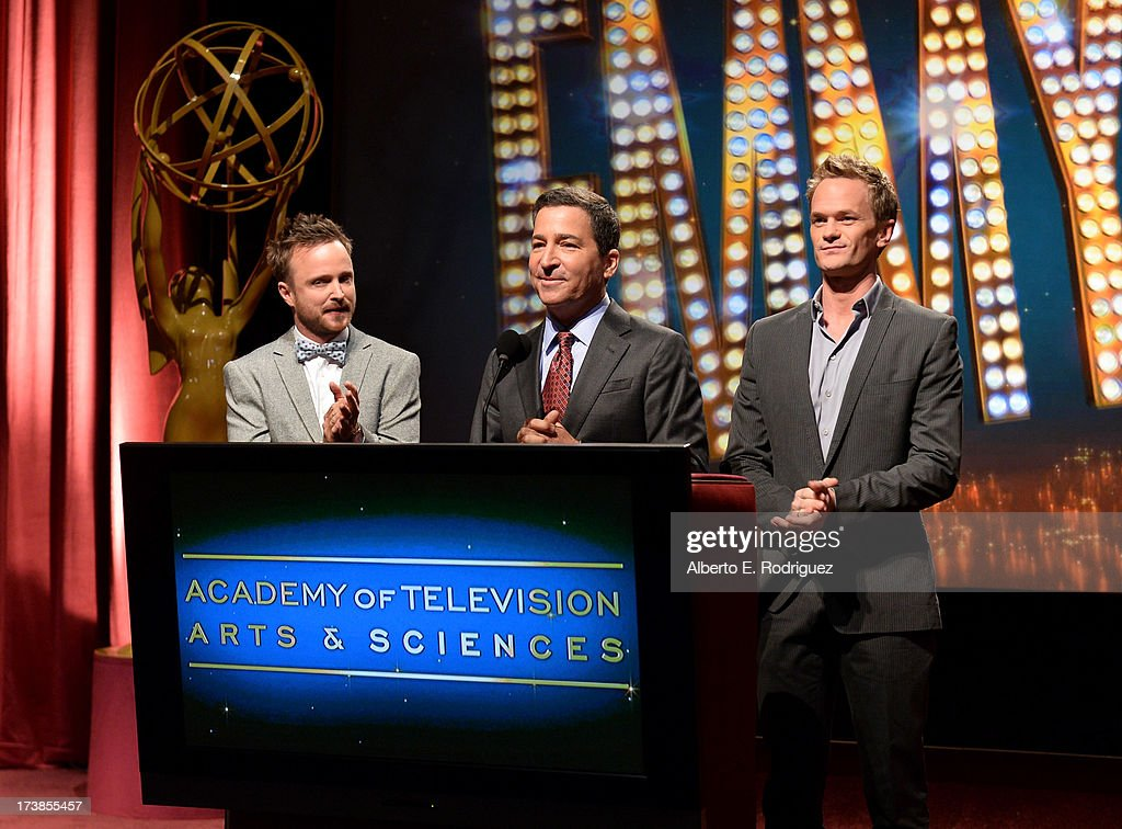 Actor Aaron Paul, Academy of Television Arts & Sciences Chairman & CEO Bruce Rosenblum and actor Neil Patrick Harris announce the nominees for the 65th Primetime Emmy Awards nominations at the Television Academy's Leonard H. Goldenson Theatre on July 18, 2013 in North Hollywood, California.
