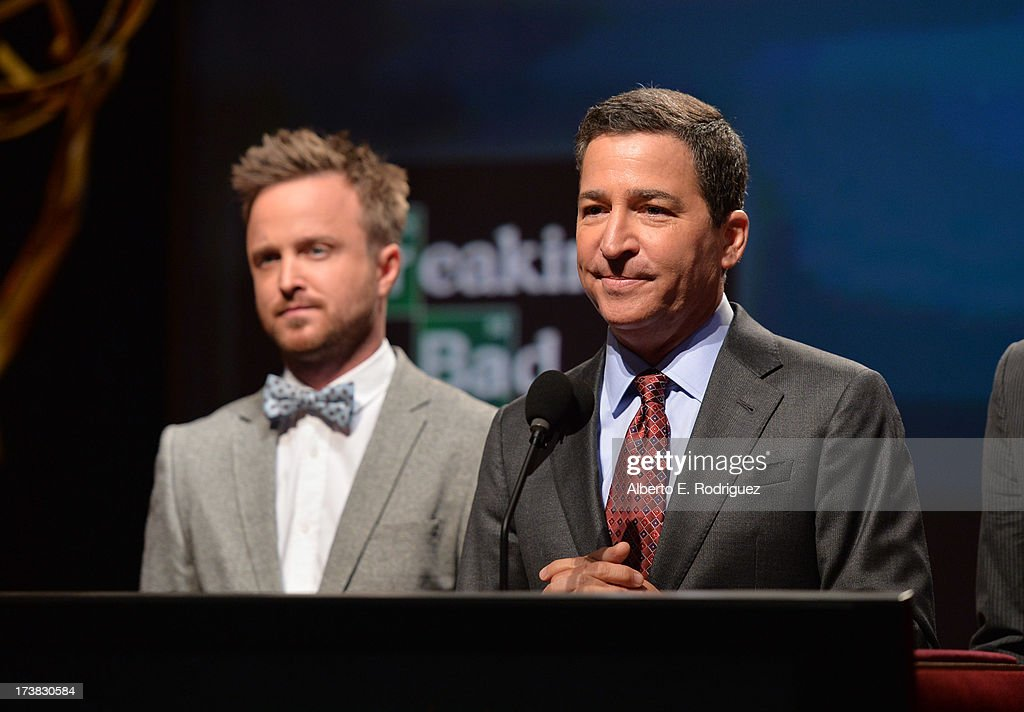 Actor Aaron Paul (L) and Academy of Television Arts & Sciences Chairman & CEO Bruce Rosenblum announce the nominees for the Outstanding Drama Series Award during the 65th Primetime Emmy Awards nominations at the Television Academy's Leonard H. Goldenson Theatre on July 18, 2013 in North Hollywood, California.