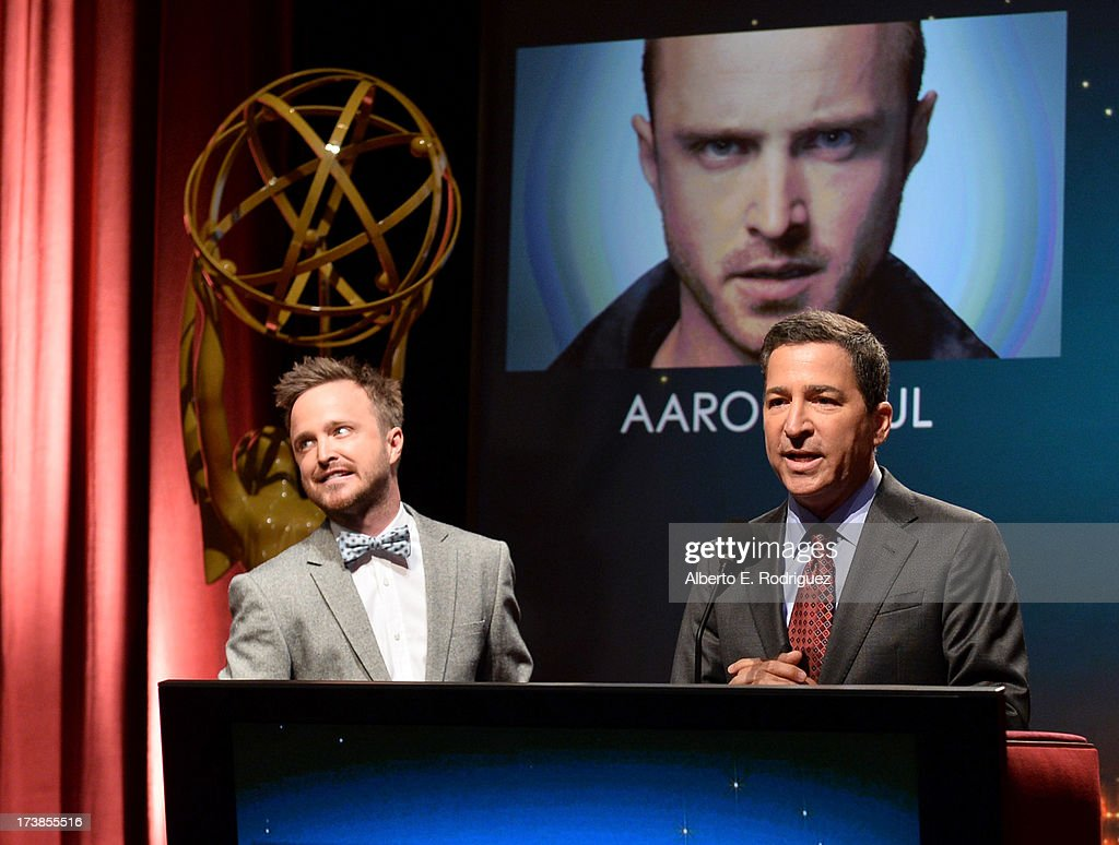 Actor Aaron Paul (L) and Academy of Television Arts & Sciences Chairman & CEO Bruce Rosenblum speak onstage at the 65th Primetime Emmy Awards nominations at the Television Academy's Leonard H. Goldenson Theatre on July 18, 2013 in North Hollywood, California.