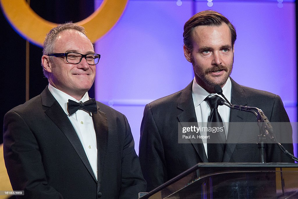 Actor Aaron Paul (R) and editor Kevin Tent, A.C.E. present the nominees for Best Edited Feature Film (Dramatic) during the 63rd Annual ACE Eddie Awards held at The Beverly Hilton Hotel on February 16, 2013 in Beverly Hills, California.
