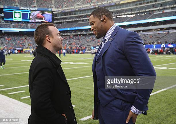 Actor Aaron Paul and former NFL player Michael Strahan attend the Pepsi Super Bowl XLVIII Pregame Show at MetLife Stadium on February 2 2014 in East...