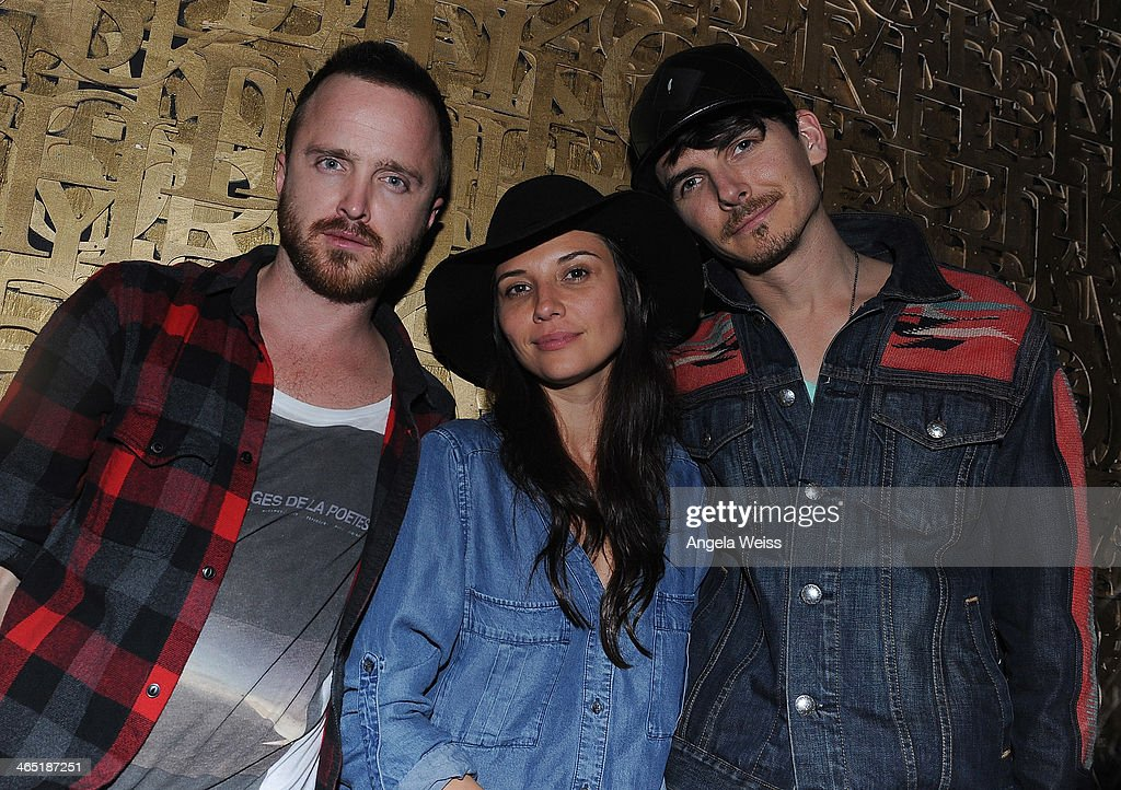 Actor Aaron Paul (L) and guests attend the 1 OAK LA Grand Opening Weekend hosted by Jay Z and presented by D'usse on January 25, 2014 in Los Angeles, California.