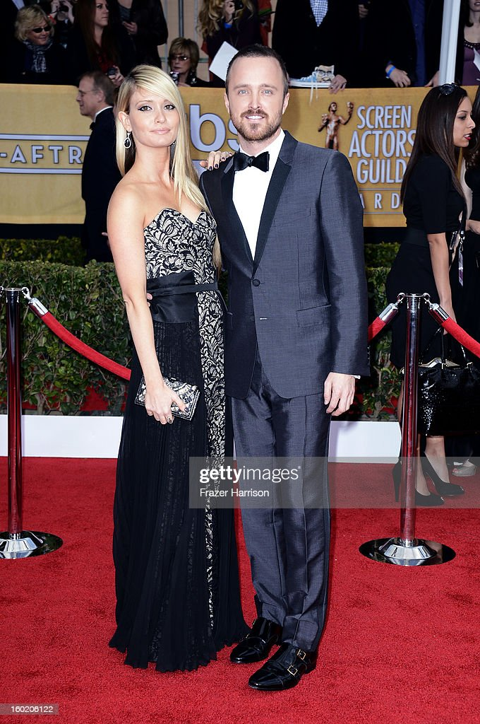 Actor Aaron Paul (R) and Lauren Parsekian arrive at the 19th Annual Screen Actors Guild Awards held at The Shrine Auditorium on January 27, 2013 in Los Angeles, California.