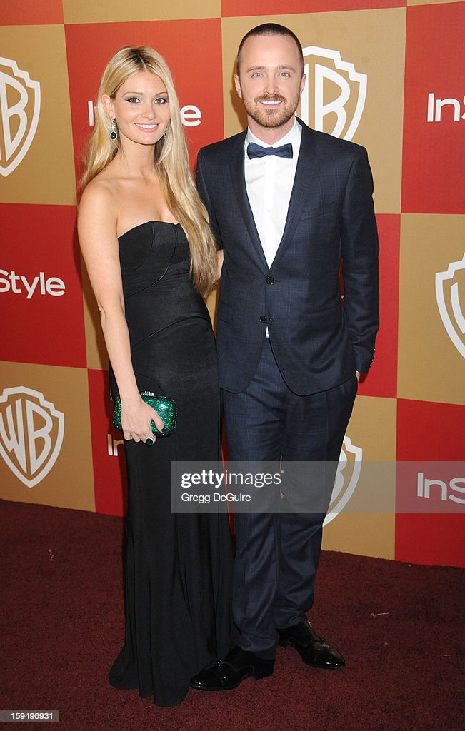 Actor Aaron Paul (R) and Lauren Parsekian arrive at the InStyle and Warner Bros. Golden Globe party at The Beverly Hilton Hotel on January 13, 2013 in Beverly Hills, California.