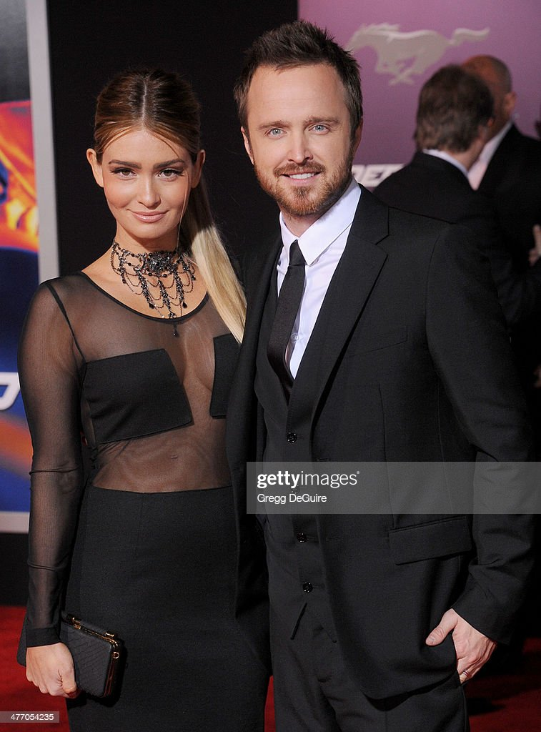 Actor Aaron Paul and Lauren Parsekian arrive at the Los Angeles premiere of 'Need For Speed' at TCL Chinese Theatre on March 6 2014 in Hollywood...