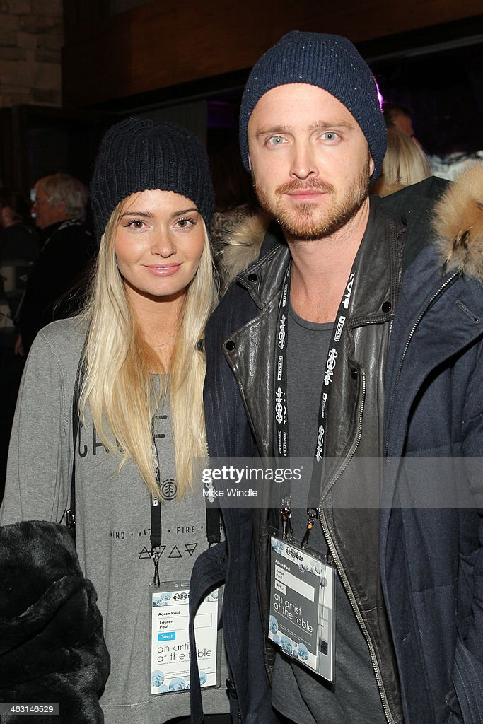 Actor Aaron Paul (R) and Lauren Parsekian attend An Artist at the Table: Dinner Program during the 2014 Sundance Film Festival at Stein Eriksen Lodge on January 16, 2014 in Park City, Utah.