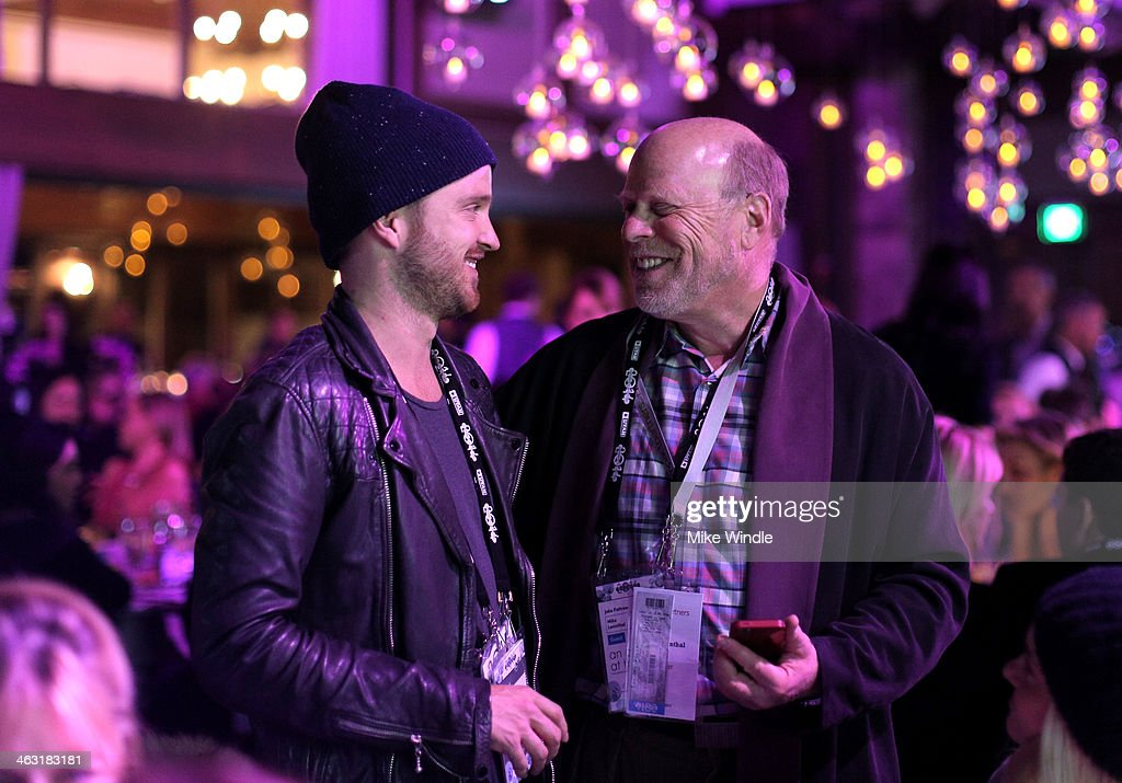 Actor <a gi-track='captionPersonalityLinkClicked' href=/galleries/search?phrase=Aaron+Paul+-+Actor&family=editorial&specificpeople=693211 ng-click='$event.stopPropagation()'>Aaron Paul</a> (R) and Mike Levinthal attend An Artist at the Table: Dinner Program during the 2014 Sundance Film Festival at Stein Eriksen Lodge on January 16, 2014 in Park City, Utah.