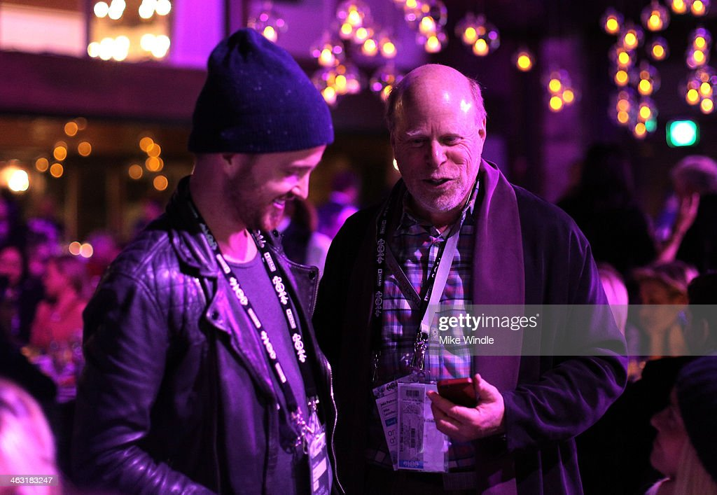 Actor Aaron Paul (R) and Mike Levinthal attend An Artist at the Table: Dinner Program during the 2014 Sundance Film Festival at Stein Eriksen Lodge on January 16, 2014 in Park City, Utah.
