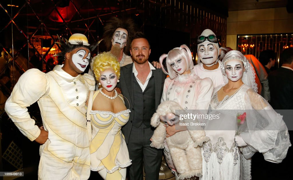 Actor <a gi-track='captionPersonalityLinkClicked' href=/galleries/search?phrase=Aaron+Paul+-+Actor&family=editorial&specificpeople=693211 ng-click='$event.stopPropagation()'>Aaron Paul</a> (C) appears with 'Zarkana by Cirque du Soleil' characters at the reception for the Las Vegas premiere of 'Zarkana by Cirque du Soleil' at the Gold Boutique Nightclub and Lounge at the Aria Resort & Casino at CityCenter on November 9, 2012 in Las Vegas, Nevada.