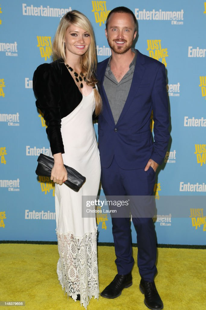 Actor <a gi-track='captionPersonalityLinkClicked' href=/galleries/search?phrase=Aaron+Paul+-+Actor&family=editorial&specificpeople=693211 ng-click='$event.stopPropagation()'>Aaron Paul</a> (R) arrives at Entertainment Weekly's Comic-Con celebration at Float at Hard Rock Hotel San Diego on July 14, 2012 in San Diego, California.