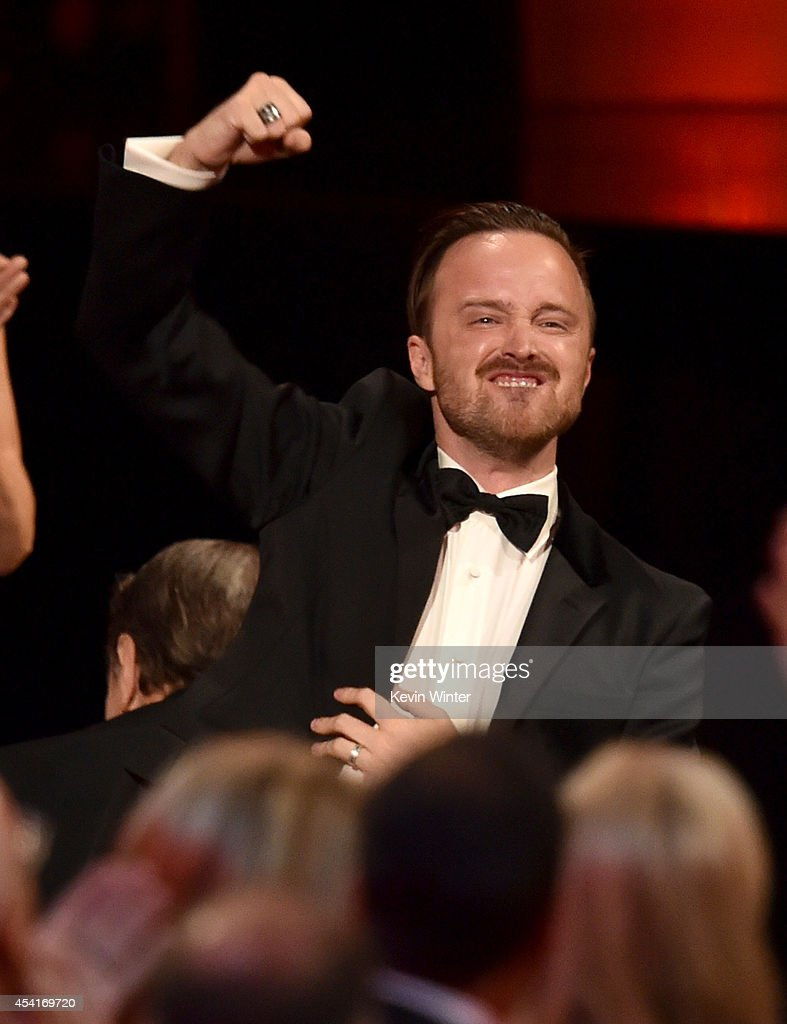 Actor <a gi-track='captionPersonalityLinkClicked' href=/galleries/search?phrase=Aaron+Paul+-+Actor&family=editorial&specificpeople=693211 ng-click='$event.stopPropagation()'>Aaron Paul</a> celebrates co-star Bryan Cranston winning Outstanding Lead Actor in a Drama Series for 'Breaking Bad' onstage at the 66th Annual Primetime Emmy Awards held at Nokia Theatre L.A. Live on August 25, 2014 in Los Angeles, California.