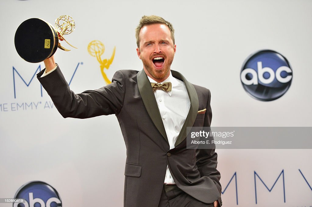 Actor <a gi-track='captionPersonalityLinkClicked' href=/galleries/search?phrase=Aaron+Paul+-+Actor&family=editorial&specificpeople=693211 ng-click='$event.stopPropagation()'>Aaron Paul</a> poses in the 64th Annual Emmy Awards press room at Nokia Theatre L.A. Live on September 23, 2012 in Los Angeles, California.