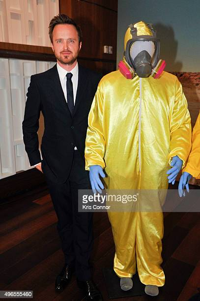 Actor Aaron Paul poses with his Tyvek suits during a donation ceremony of artifacts from AMC's 'Breaking Bad' show at Smithsonian's National Museum...