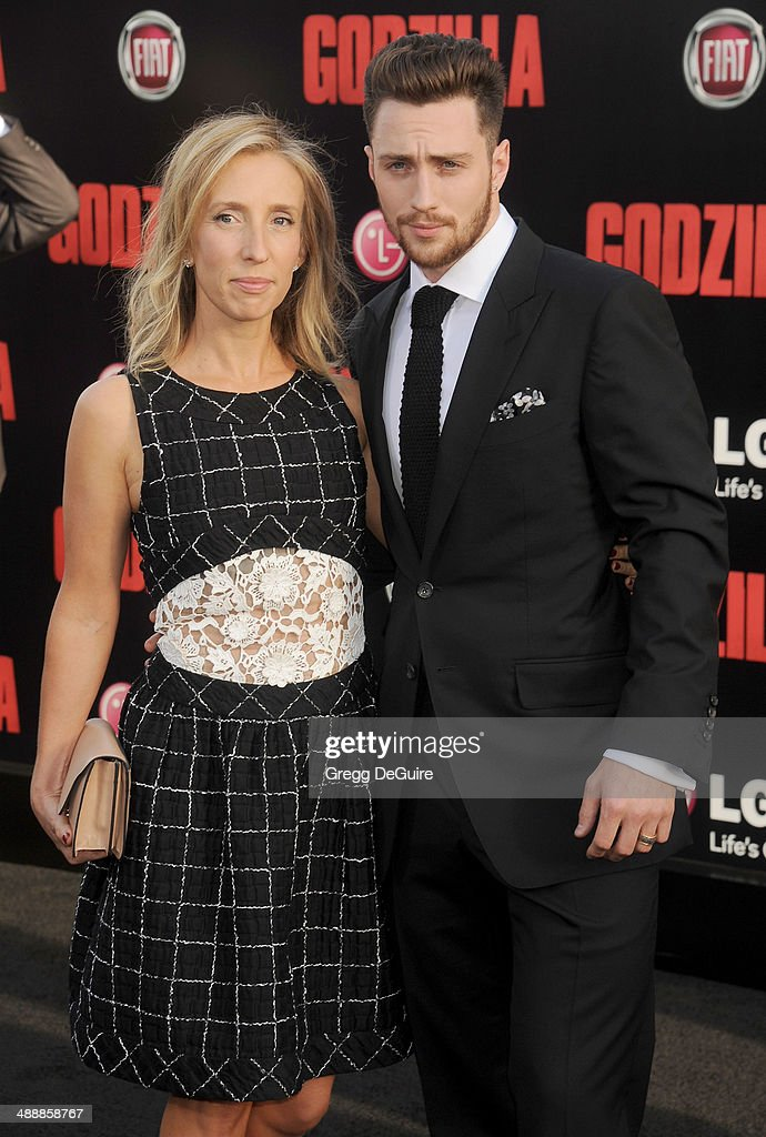 Actor Aaron Taylor-Johnson and <a gi-track='captionPersonalityLinkClicked' href=/galleries/search?phrase=Sam+Taylor-Wood&family=editorial&specificpeople=206600 ng-click='$event.stopPropagation()'>Sam Taylor-Wood</a> arrive at the Los Angeles premiere of 'Godzilla' at Dolby Theatre on May 8, 2014 in Hollywood, California.