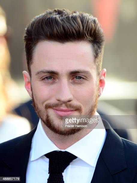 Actor Aaron TaylorJohnson attends the premiere of Warner Bros Pictures and Legendary Pictures' 'Godzilla' at Dolby Theatre on May 8 2014 in Hollywood...