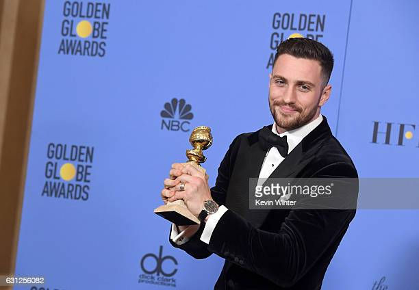 Actor Aaron TaylorJohnson winner of Best Supporting Actor in a Motion Picture for 'Nocturnal Animals' poses in the press room during the 74th Annual...