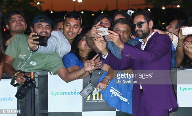 Actor Abhay Deol poses with the fans at the 2017 International Indian Film Academy Festival at MetLife Stadium on July 14 2017 in East Rutherford New...