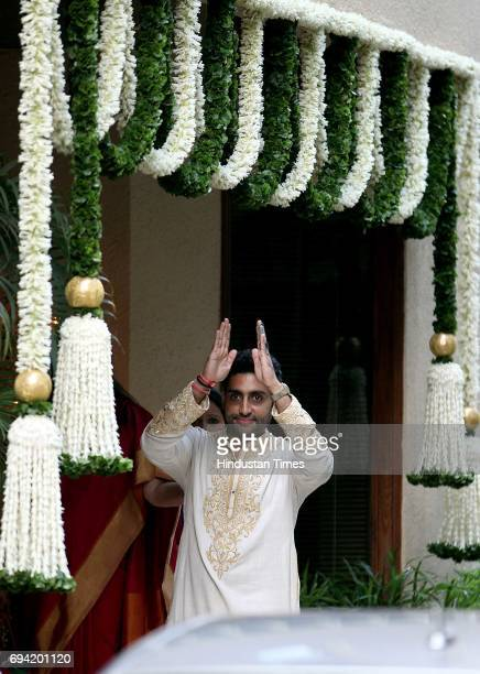 Actor Abhishek Bachchan gestures at the media waiting outside his residence 'Jalsa' after the 'God Bharai ceremony of his wife Aishwarya Rai bachchan...