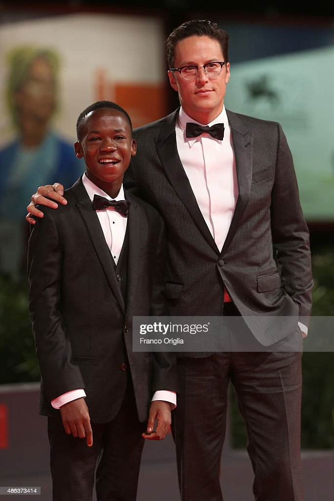 Actor Abraham Attah and director Cary Fukunaga attend the premiere of 'Beasts Of No Nation' during the 72nd Venice Film Festival on September 3, 2015 in Venice, Italy.