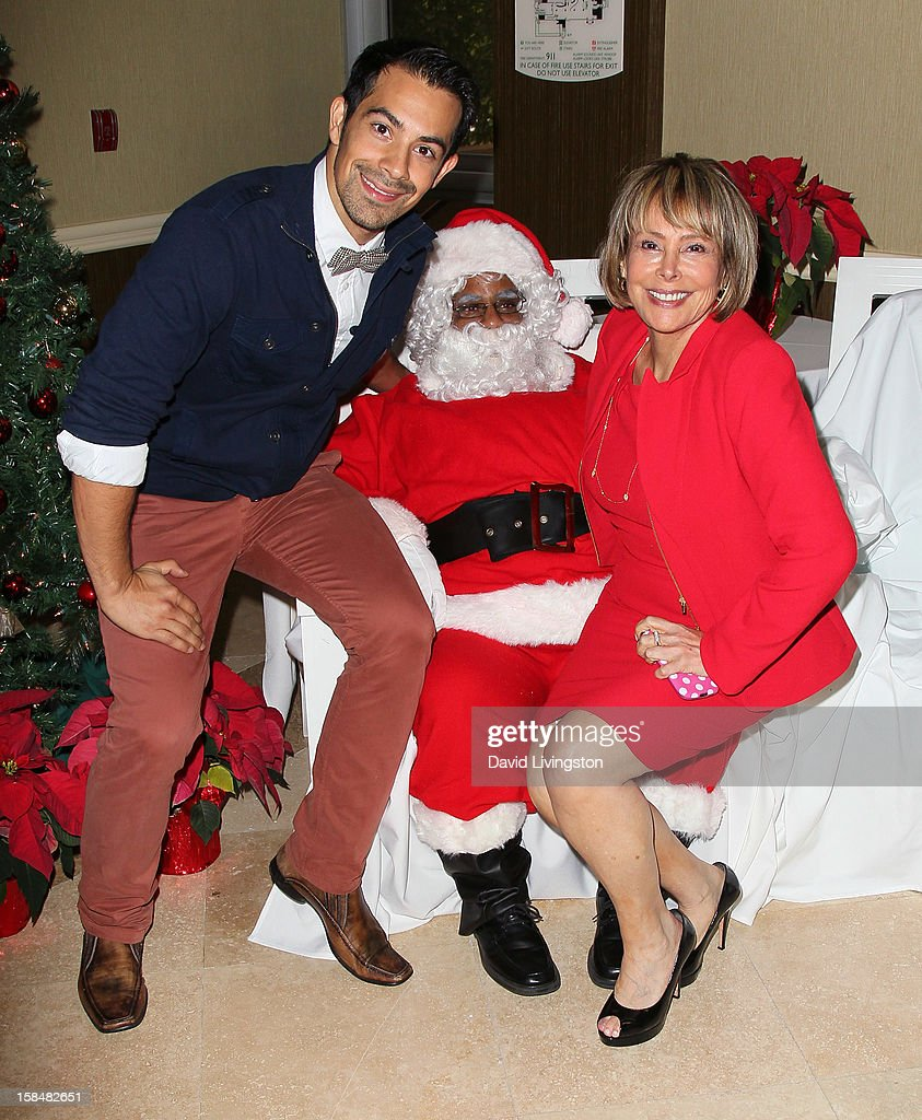 Actor Ace Marrero (L) and Working Dreams founder Lola Levoy attend the Working Dreams and Families For Children annual holiday season event at the Marriott Courtyard on December 17, 2012 in Culver City, California.