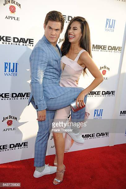 Actor Adam Devine and actress Chloe Bridges attend the premiere of 20th Century Fox's 'Mike And Dave Need Wedding Dates' held at Cinerama Dome at...