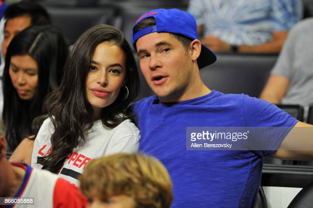 Actor Adam DeVine and Chloe Bridges attend a basketball game between the Los Angeles Clippers and the Utah Jazz at Staples Center on October 24 2017...