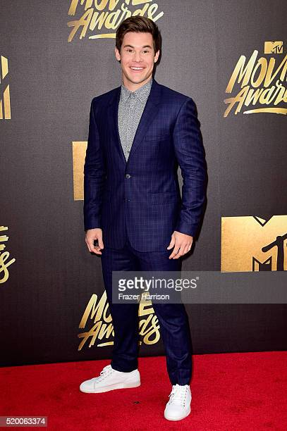 Actor Adam DeVine attends the 2016 MTV Movie Awards at Warner Bros Studios on April 9 2016 in Burbank California MTV Movie Awards airs April 10 2016...
