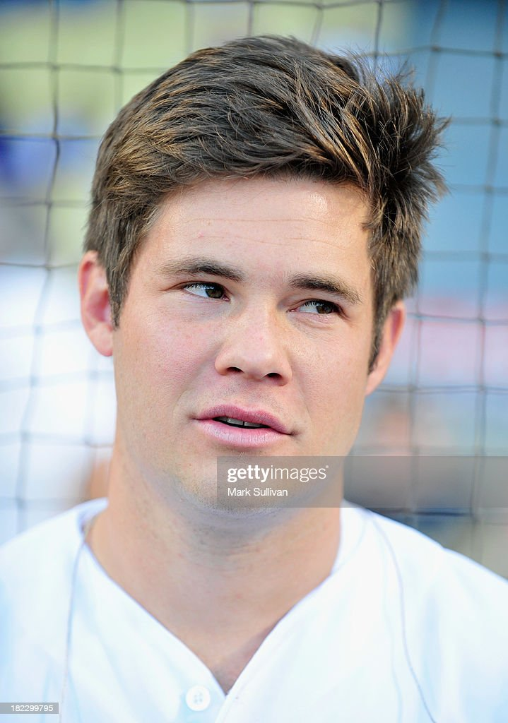 Actor Adam Devine on the field before singing the national anthem before the MLB game between the Colorado Rockies and Los Angeles Dodgers at Dodger Stadium on September 28, 2013 in Los Angeles, California.
