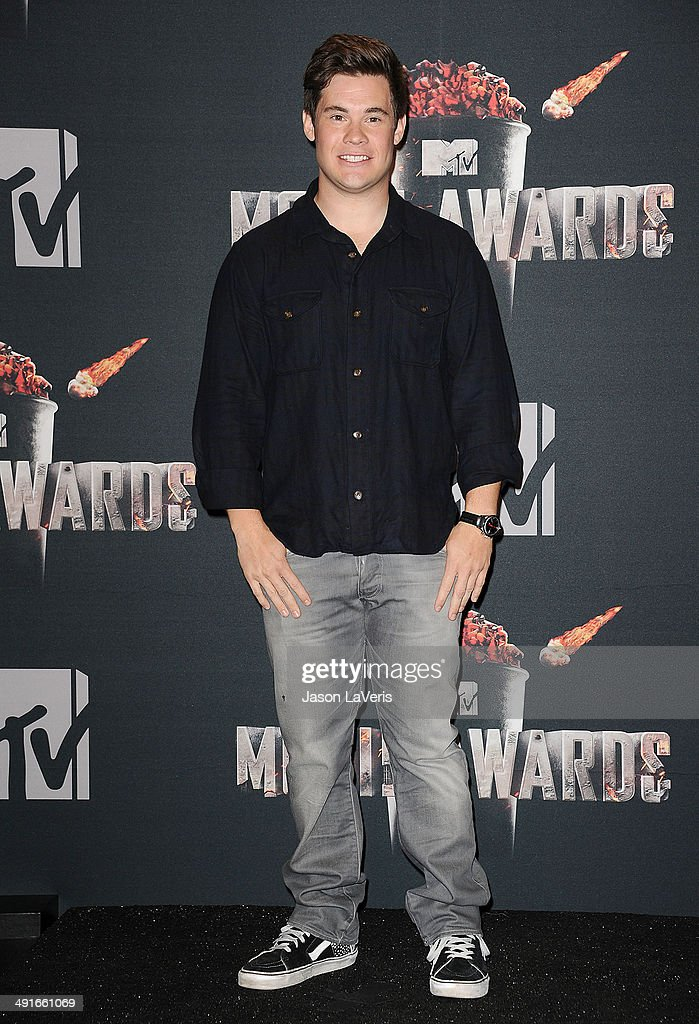 Actor Adam DeVine poses in the press room at the 2014 MTV Movie Awards at Nokia Theatre L.A. Live on April 13, 2014 in Los Angeles, California.