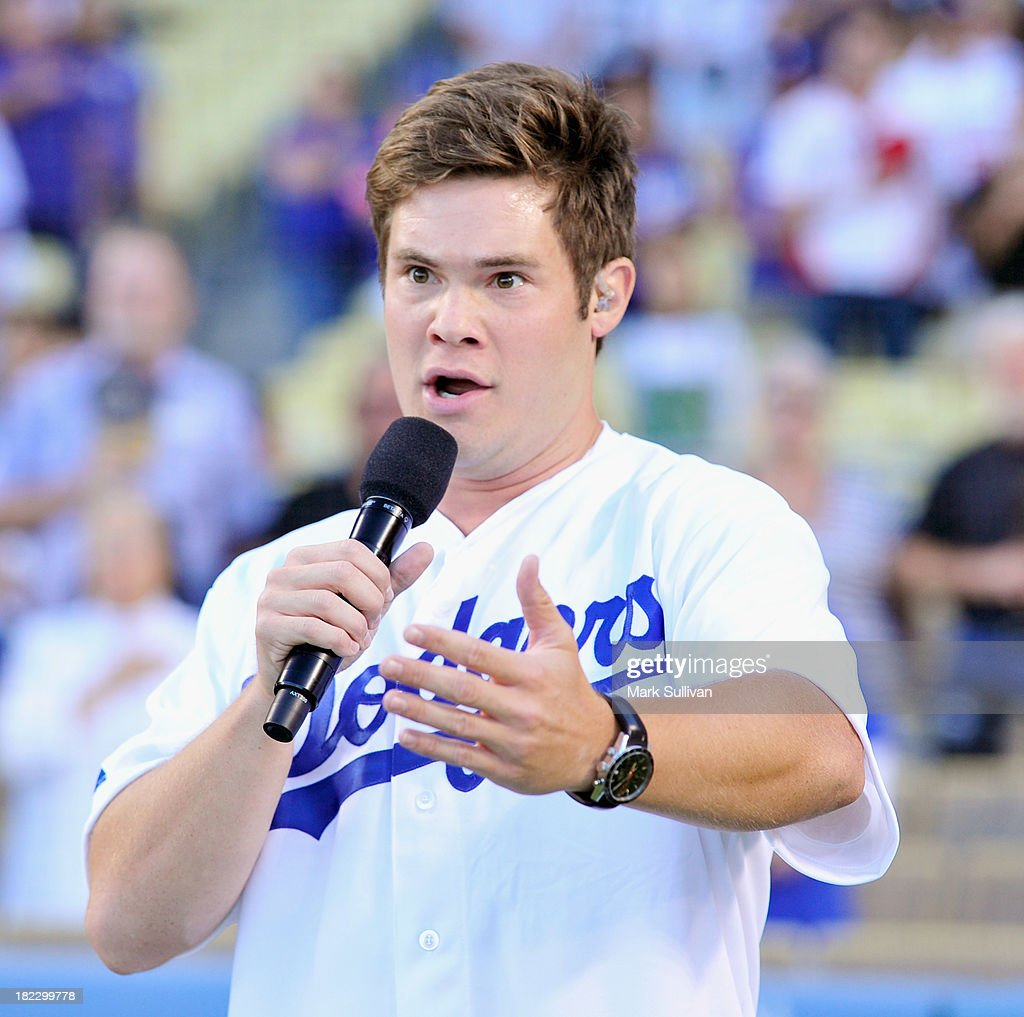 Actor Adam Devine sings the national anthem before the MLB game between the Colorado Rockies and Los Angeles Dodgers at Dodger Stadium on September 28, 2013 in Los Angeles, California.